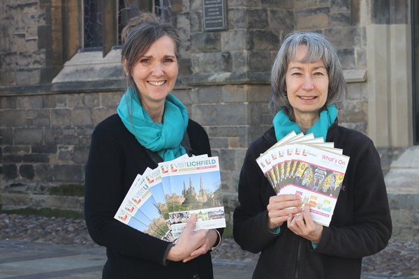 TIC staff with brochures